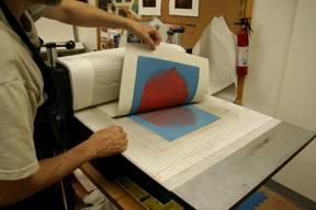 artist pulling a monotype